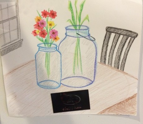 The jars drawn with crayons is hanging on a fridge, but this gives you the idea.